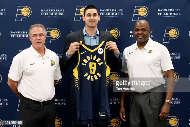 President of Basketball Operations Kevin Pritchard and Head Coach Nate McMillan of the Indiana Pacers pose for a portrait with 2019 NBA Draftee Goga...
