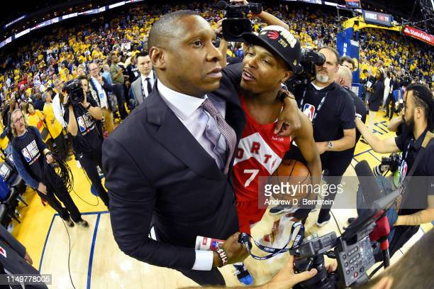 President of Basketball Operations Masai Ujiri and Kyle Lowry of the Toronto Raptors celebrate after Game Six of the NBA Finals against the Golden...