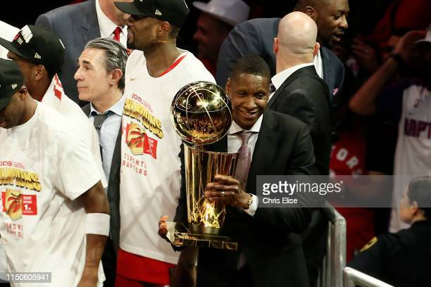 President of Basketball Operations Masai Ujiri holds the Larry O'Brien Championship Trophy after Game Six of the NBA Finals against the Golden State...