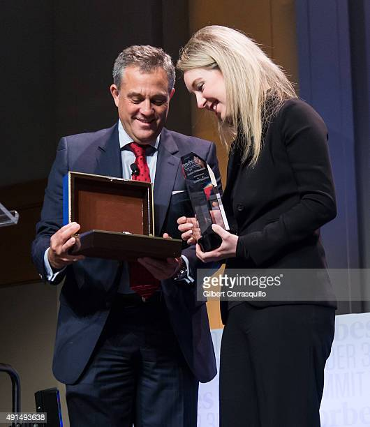 President of Baume Mercier Rudy Chavez presents the Under 30 Doers Award to Founder CEO of Theranos Elizabeth Holmes during the Forbes Under 30...