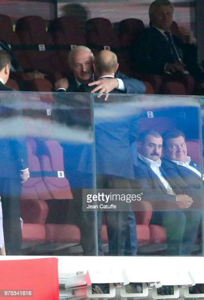 President of Belarus Alexander Lukashenko hugs President of Russia Vladimir Putin during the 2018 FIFA World Cup Russia group A match between Russia...
