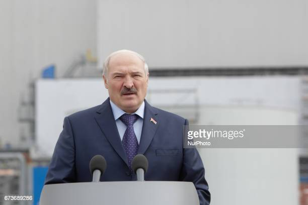 President of Belarus Alexander Lukashenko talks to media in front of the Chornobyl NPP newly raised safe confinement during the meeting to...