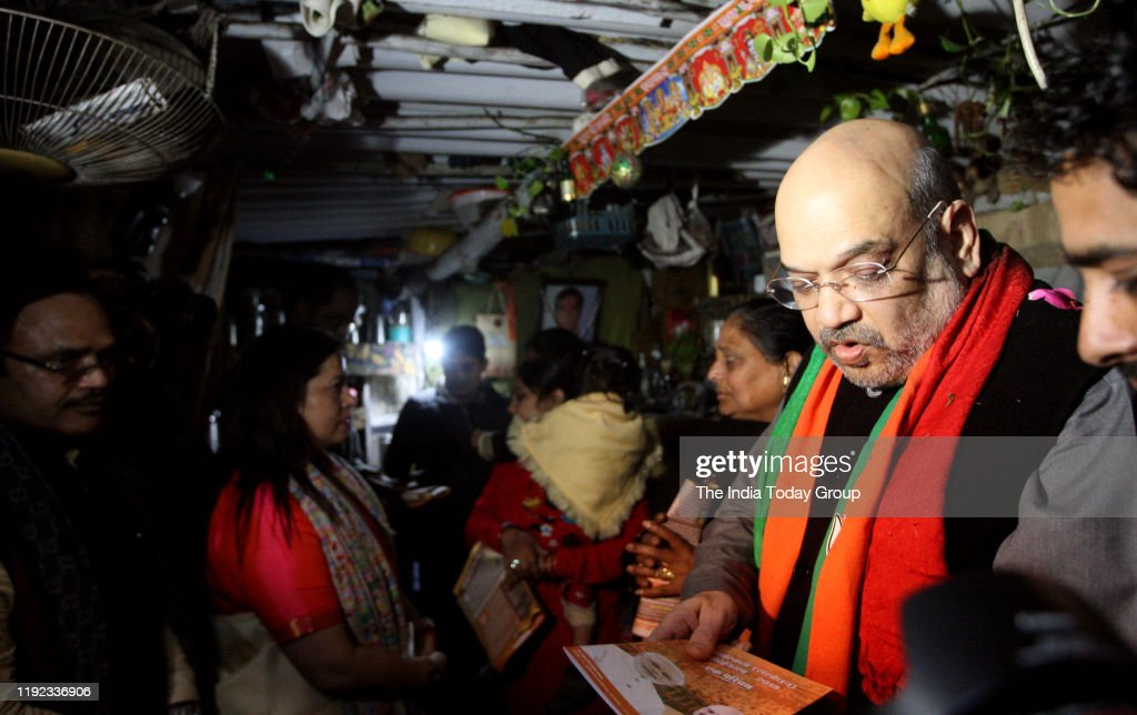 Amit Shah during door to door campaign for CAA : News Photo
