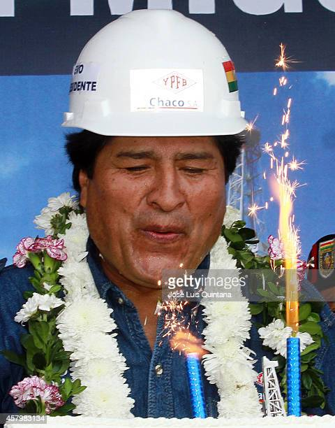 President of Bolivia Evo Morales blows out the candles of his cake during the celebration of his 55th birthday during a tour of inspection at San...