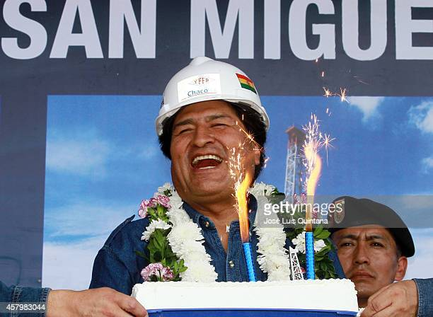 President of Bolivia Evo Morales laughs during the celebration of his 55th birthday during a tour of inspection at San MiguelX1 well on October 26...