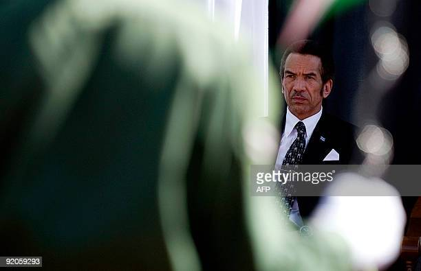 President of Botswana Ian Khama inspects the guard of honour after his swearing in as the President of the Republic of Botswana in Gaborone on...