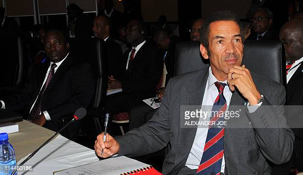 President of Botswana Ian Khama sits next to President of the Democratic Republic of Congo Joseph Kabila during the opening of the Southern African...