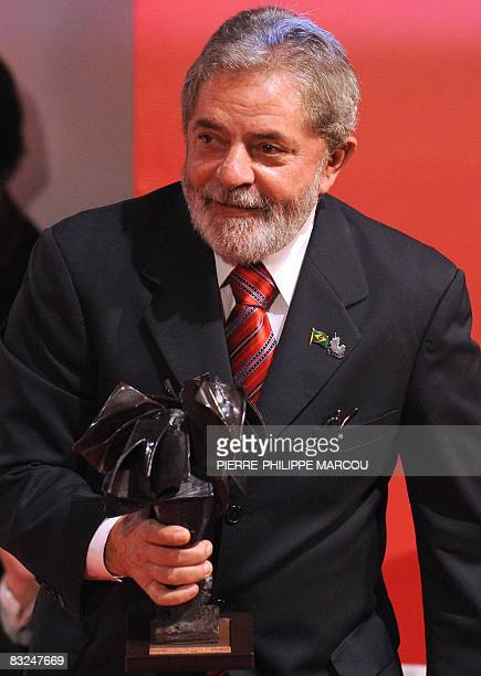 President of Brazil Inazio Lula Da Silva holds the Don Quijote de La Mancha International Award trophy during a ceremony in Toledo on October 13 2008...