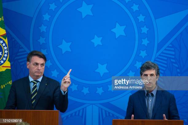President of Brazil Jair Bolsonaro and Health Minister Nelson Teich speak during a press conference to announce Teich as newly appointed Health...