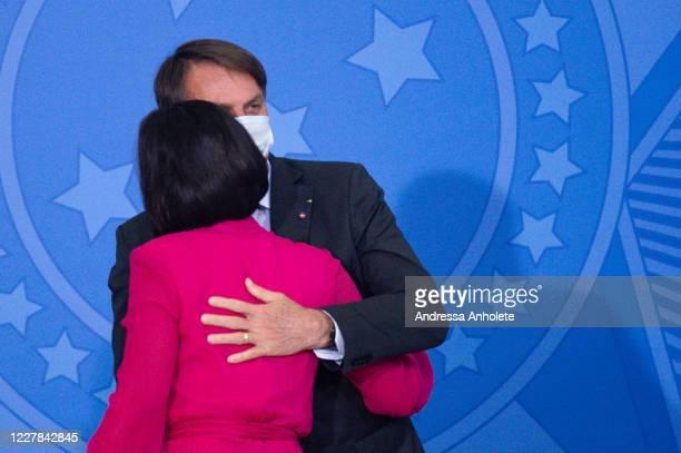 President of Brazil Jair Bolsonaro and his wife Michelle Bolsonaro embrace during launch the Rural Women Campaign amidstthe coronavirus pandemic at...