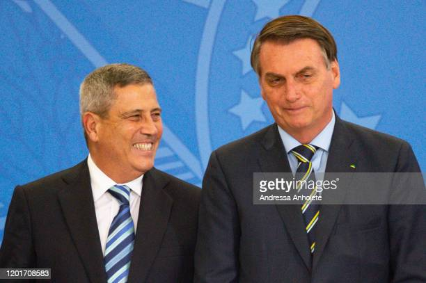 President of Brazil Jair Bolsonaro and new Minister of the Civil House General Walter Souza Braga Netto smile during the Transmission Ceremony of the...