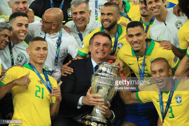 President of Brazil Jair Bolsonaro celebrates with the trophy and the players of Brazil after winning the Copa America Brazil 2019 Final match...