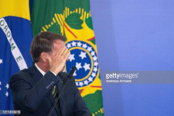 President of Brazil Jair Bolsonaro gestures during the sworn in ceremony for newly appointed Justice Minister André Luiz Mendonça and new brazilian...