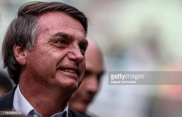 President of Brazil Jair Bolsonaro looks on before a match between Palmeiras and Vasco for the Brasileirao Series A 2019 at Allianz Parque on July 27...
