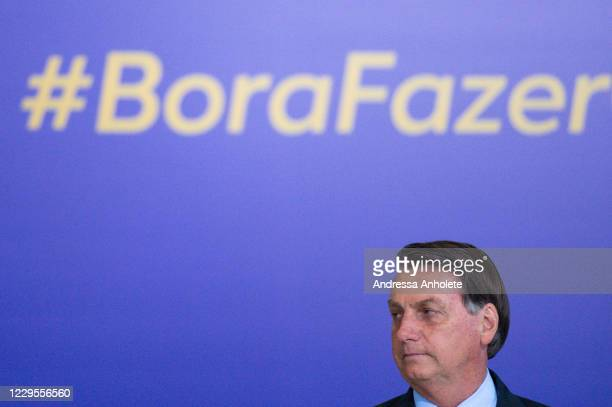 President of Brazil Jair Bolsonaro looks on during Volunteering Alliance launch amidst the coronavirus pandemic at the Planalto Palace on...