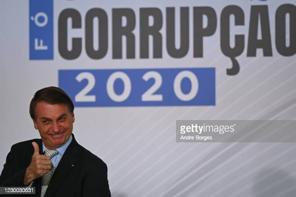 "President of Brazil Jair Bolsonaro reacts during the opening ceremony of the forum ""The Control in Combating Corruption"" amidst the Coronavirus..."