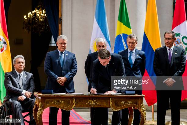 President of Brazil Jair Bolsonaro signs the agreement of Santiago after the Meeting of Presidents of South America also called ProSur on March 22...