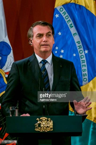 President of Brazil Jair Bolsonaro speaks after a bilateral meeting at the Palacio de La Moneda on March 23 2019 in Santiago Chile