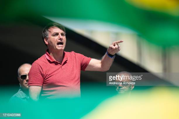 President of Brazil Jair Bolsonaro speaks to supporters in front of the Brazilian Headquarters on April 2020 in Brasilia Protesters held a motorcade...