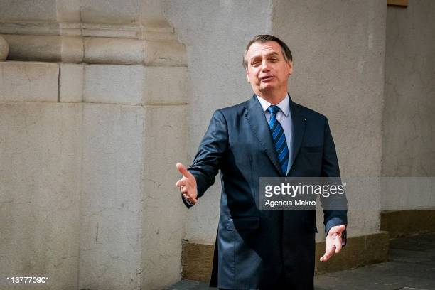 President of Brazil Jair Bolsonaro speaks with the press upon his arrival at the Palacio de La Moneda during his official visit to Chile on March 23...