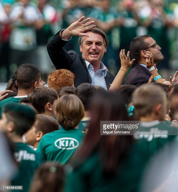 President of Brazil Jair Bolsonaro waves before a match between Palmeiras and Vasco for the Brasileirao Series A 2019 at Allianz Parque on July 27...