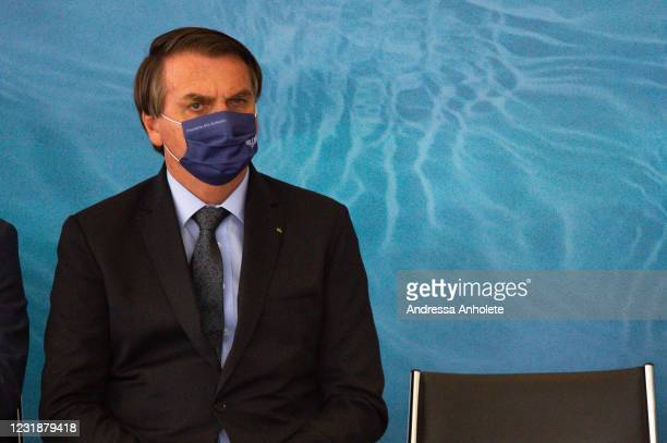 President of Brazil Jair Bolsonaro looks on during the launch of Programa Aguas Brasileiras amidst the coronavirus pandemic at the Planalto Palace on...