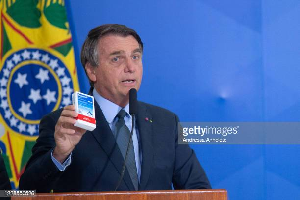 President of Brazil Jair Bolsonaro shows a box of chloroquine medicine during the ceremony in which Eduardo Pazuello takes office as Minister...
