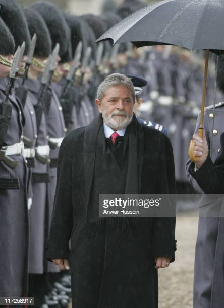 President of Brazil Luiz Inacio Lula da Silva and Prince Philip Duke of Edinburgh inspect the Guard of Honour during a ceremonial welcome at Horse...