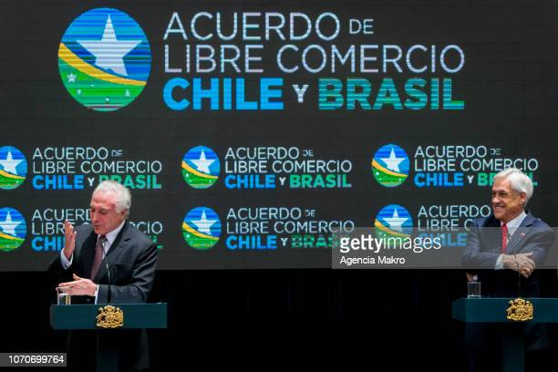 President of Brazil Michel Temer gives a speech as President of Chile Sebastián Piñera smiles after the signing of a Free Trade Agreement between...