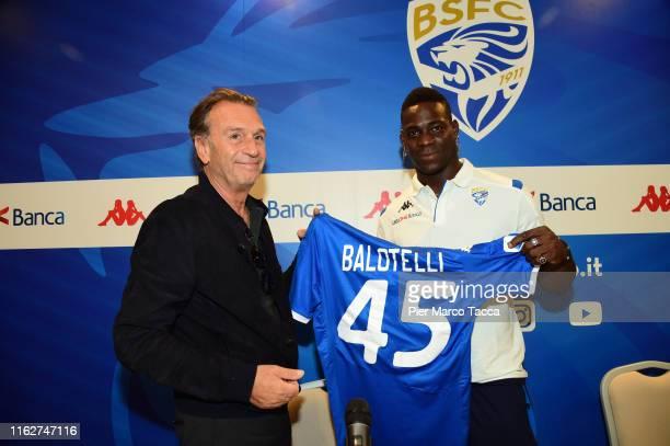 President of Brescia Calcio Massimo Cellino and Mario Balotelli show the Brescia Calcio jersey during Brescia Calcio Unveils New Signing Mario...