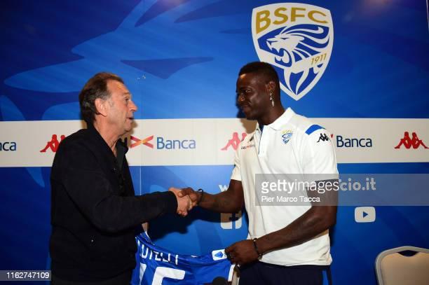 President of Brescia Calcio Massimo Cellino shakes hands with Mario Balotelli during Brescia Calcio Unveils New Signing Mario Balotelli on August 19...