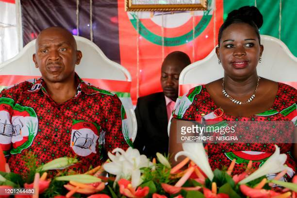 President of Burundi's National Congress for Freedom Agathon Rwasa and his wife Annonciate attend the party's national convention on February 16 2020...