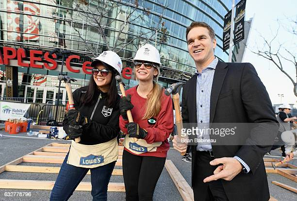President of business operations Luc Robitaille of the Los Angeles Kings poses with crew members from Habitat For Humanity during the build outside...