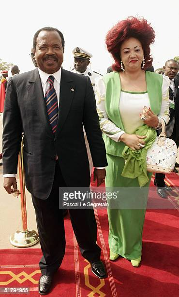 President of Cameroon and his wife Chantal Biya pose as they arrive to attend the 10th Francophonie summit on November 26 2004 in Ouagadougou...