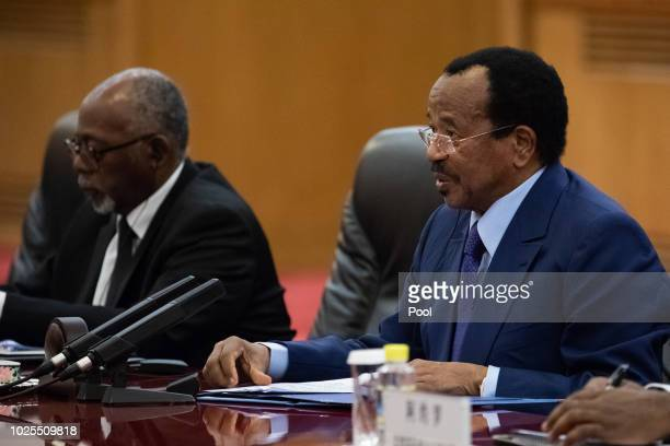President of Cameroon Paul Biya talks to China's President Xi Jinping during their bilateral meeting at the Great Hall of the People on August 31,...