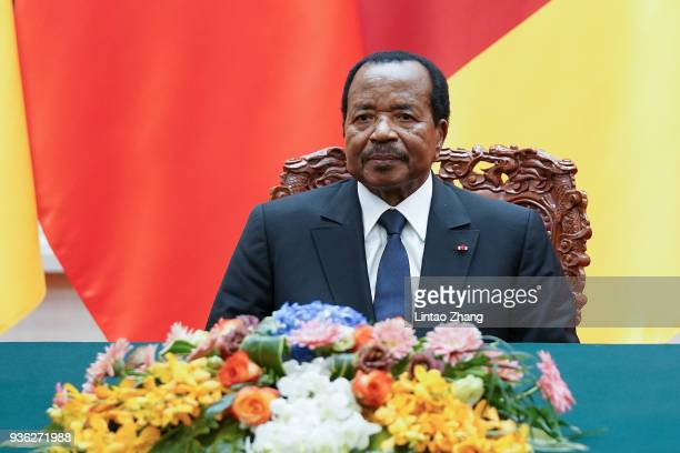 President of Cameroon Paul Biya with Chinese President Xi Jinping attend a signing ceremony at The Great Hall Of The People on March 22, 2018 in...