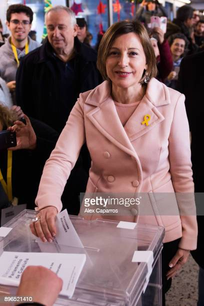 President of Catalan Parliament and 'Esquerra Republicana de Catalunya' ERC candidate Carme Forcadell casts her ballot for the Catalan regional...