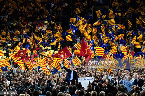 President of Catalonia and President of the Proindependent political party Convergence and Union Artur Mas waves to supporters during the closing...