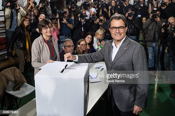 President of Catalonia Artur Mas casts his vote at a polling station on November 9 2014 in Barcelona Spain Catalans vote today during an unofficial...