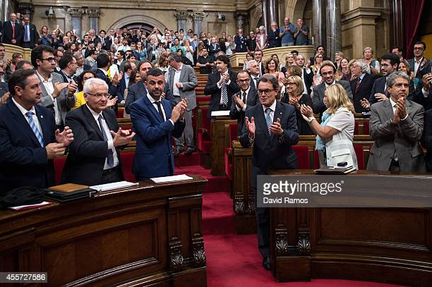 President of Catalonia Artur Mas celebrates after the Catalan Parliament approved the Law allowing Catalonia's Government to call on a...