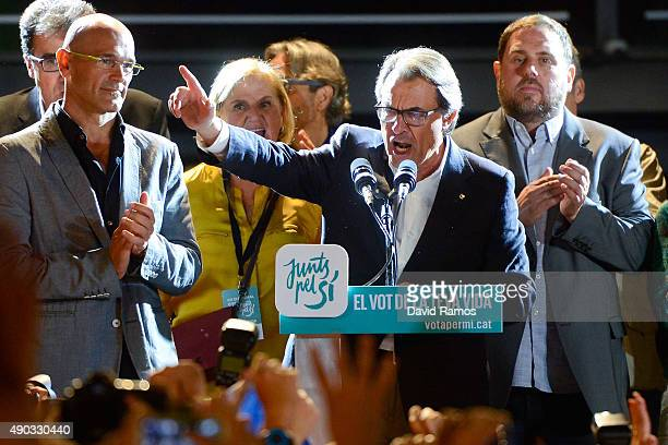 President of Catalonia Artur Mas celebrates as he speaks to wellwishers after the Catalanist coalition 'Junts pel Si' claimed victory in the regional...