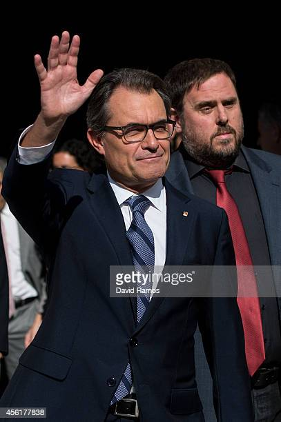 President of Catalonia Artur Mas waves as he leaves the Palau de la Generalitat the Catalan government building next to the Leader of the...