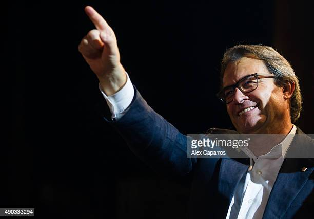 President of Catalonia Artur Mas waves to wellwishers after the Catalanist coalition 'Junts pel Si' won the regional elections held in Catalonia on...