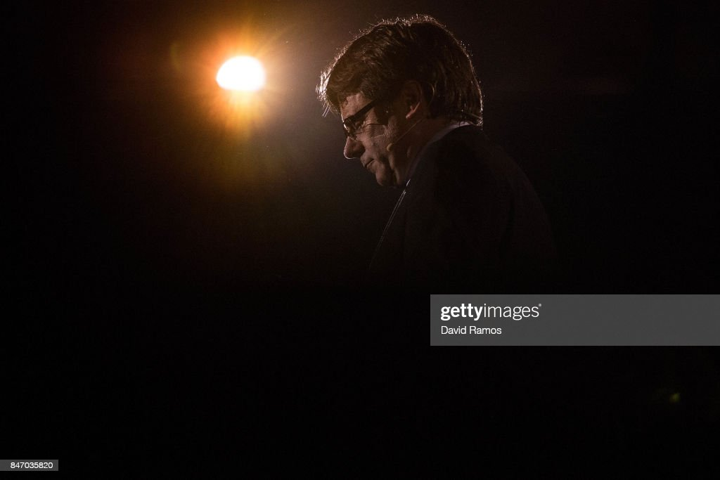 President of Catalonia Carles Puigdemont delivers a speech during a meeting to launch the Self-Determination referendum campaign on September 14, 2017 in Tarragona, Spain. The vote on breaking away from Spain was called by the Catalan governemnt for October 1, 2017 but is suspended by the Spain's Constitutional Court following a demand from the Spanish Government. Catalan and Spanish security forces have been instructed by the Spain's Public Prosecutor's Office to take all the elements which could promote or help to celebrate the referendum. This includes ballots, ballots boxes, promotional material. Following these instructions, 712 Catalan mayors were summoned by the Spain's State Prosecutor over independence vote, threatening arrests over non-cooperation.