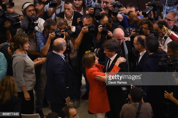 President of Catalonia Carles Puigdemont hugs Catalan Parliament President Carme Forcadell after the session at the Palau del Parlament de Catalunya...