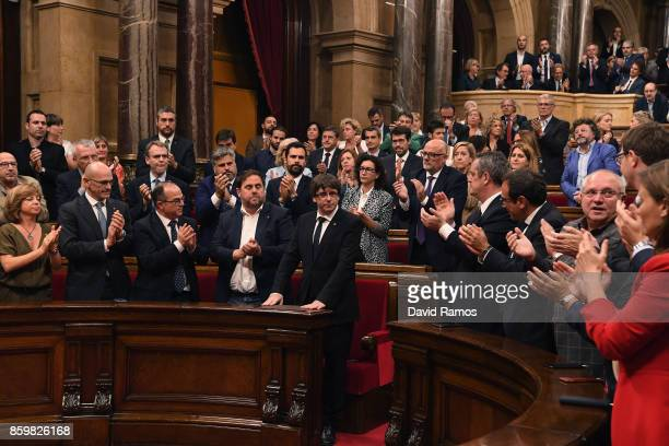 President of Catalonia Carles Puigdemont is applauded after his address to the Catalan Parliament at the Palau del Parlament de Catalunya on October...