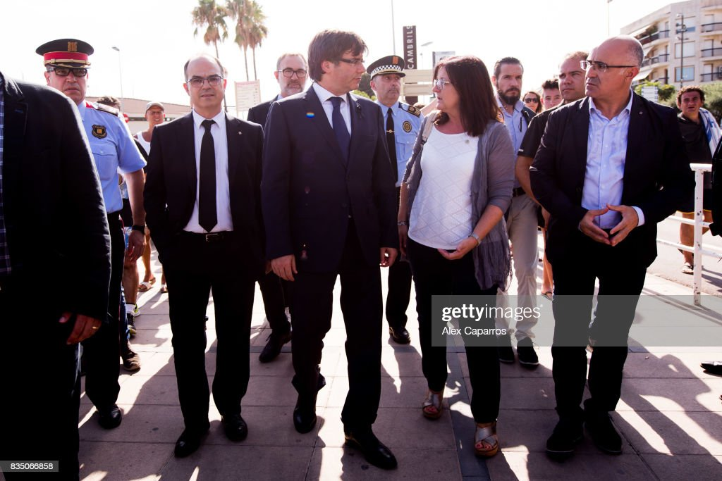 President of Catalonia Carles Puigdemont walks between Minister of the Presidency Jordi Turull (L) and Mayor of Cambrils Cami Mendoza (R) after visiting the spot where five terrorists were shot by police on August 18, 2017 in Cambrils, Spain. Fourteen people were killed and dozens injured when a van hit crowds in the Las Ramblas area of Barcelona on Thursday. Spanish police have also killed five suspected terrorists in the town of Cambrils to stop a second terrorist attack.