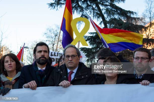 President of Catalonia Quim Torra and Catalan regional parliament speaker Roger Torrent stands with a banner reading 'To decide is not a crime' near...