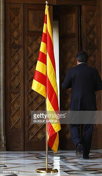 President of Catalonia's regional government Artur Mas leaves a press conference at the Palau de la Generalitat in Barcelona following the abdication...