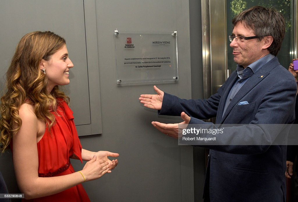 President of Catalunya Carles Puigdemont (R) and Mireia Vidal (L) attend the inauguration of the new store of Mireia Vidal Bridal on May 21, 2016 in Barcelona, Spain.